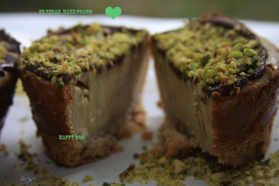 Vegan pistachio vanilla lemon baby cheesecakes and almond crust, love,no dairy. Perfect for Valentine's Day.