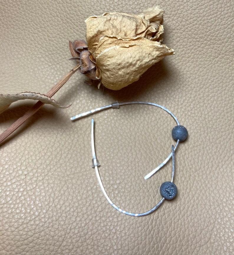 Our custom hammers drop earring
