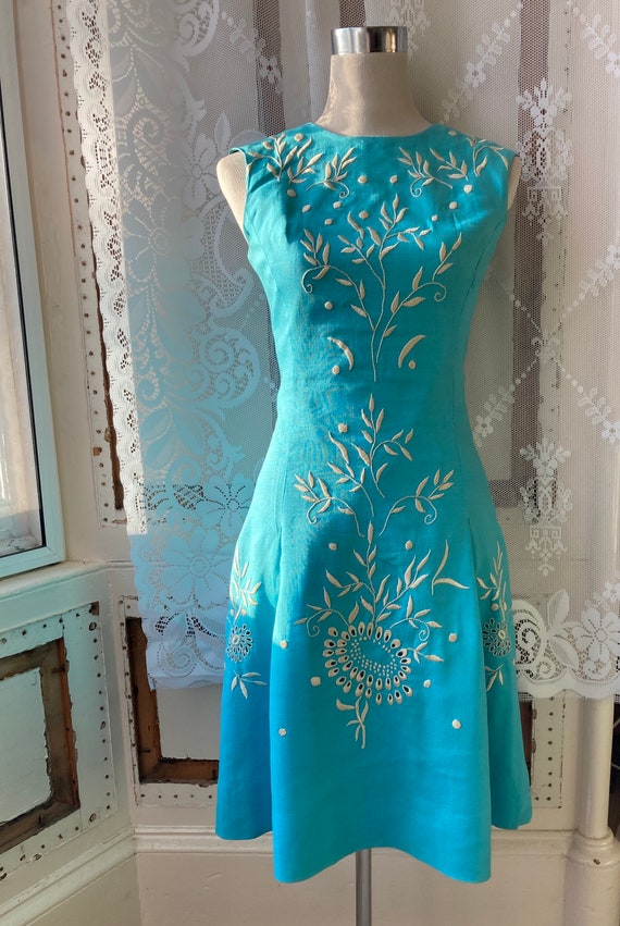 60s Mad Men-style turquoise pale blue sun dress wi