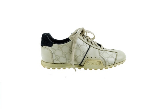 GUCCI  Guccissima GG Embossed Leather Sneakers