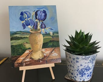 Tuscany with Blue Iris Flowers in Tuscan Ceramic Vase, original oil on hard artist panel by Dutch nature artist Paula Kuitenbrouwer.