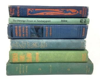 Vintage hardcover book stack blues greens