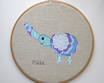 Your child's drawing appliqued in hoop frame. Personalised patchwork and embroidery using your own child's design.