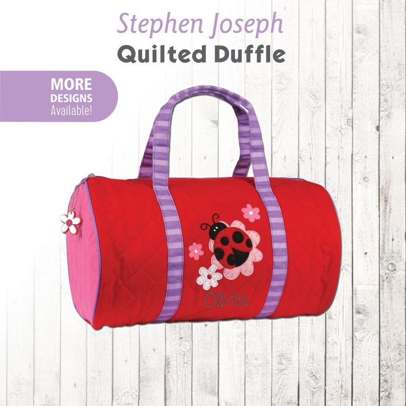 Stephen Joseph Dino Quilted Duffle bag with Additional Zipper Pull