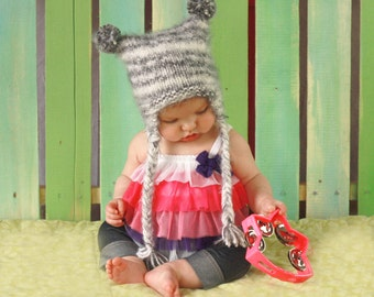 The Pom pom kids hat with earflaps for winter snow fun