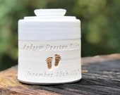 infant urn. size xs shown. Personalized name. shown in white and dove grey with footprint gold upgrade
