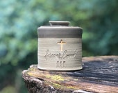 urn. lidded customized urn for partial adult cremains, custom color, text. shown in sand clay with dove grey glaze with gold cross upgrade