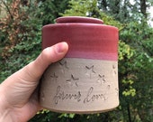 ready made urn. Stoneware clay pottery urn, pet urn or small urn dor ashes. Red glaze and star shaped stamps.