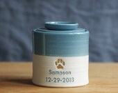 custom urn . Personalized pet urn for ashes. french blue on porcelain with gold paw upgrade shown.