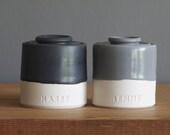 custom urn. straight shaped urn with custom name. modern urn for ashes. black on white porcelain