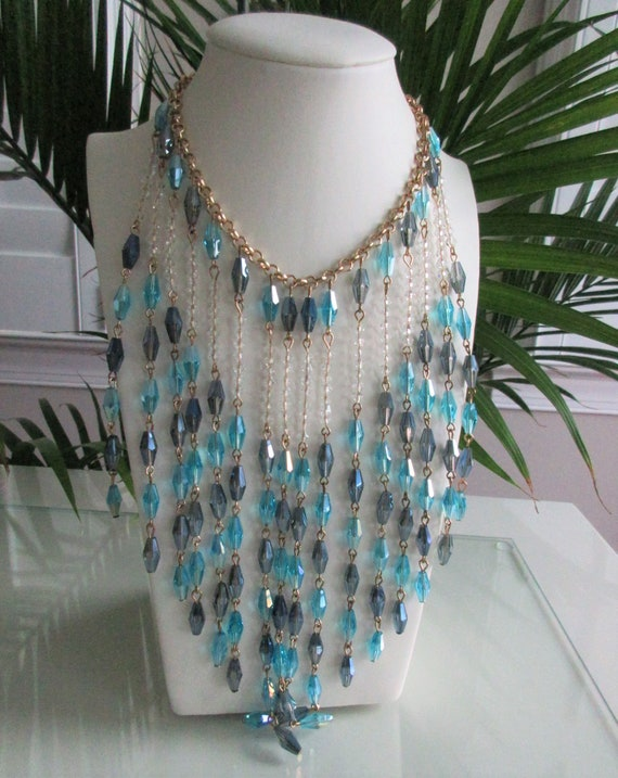 Lovely necklace. 1928 bib necklace Clear beads and white cabs with goldtone metal flowers and colored rhinestones