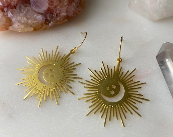 She is GLOWING gold golden celestial starlight moon dangle earrings
