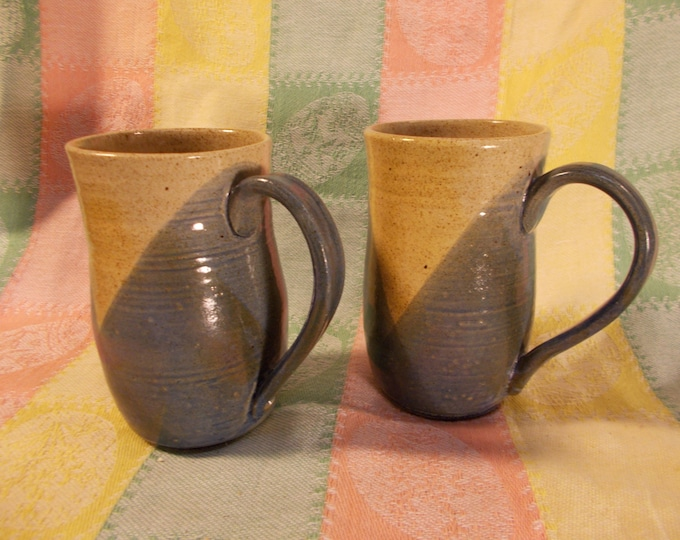 Blue speckled stoneware coffee tea or beer mugs or cups