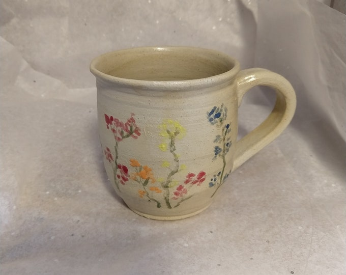 Small coffee mug with over painted flowers holds 8oz