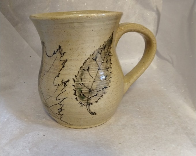 Coffee mug with underglaze leaves with slip trailed detail holds 14oz