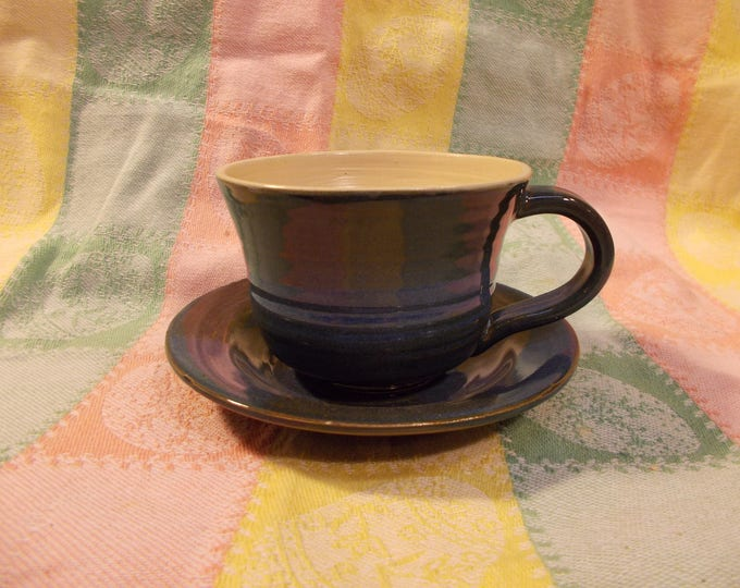 Cup and saucer for tea, coffee, soup, with a blue varigated glaze.