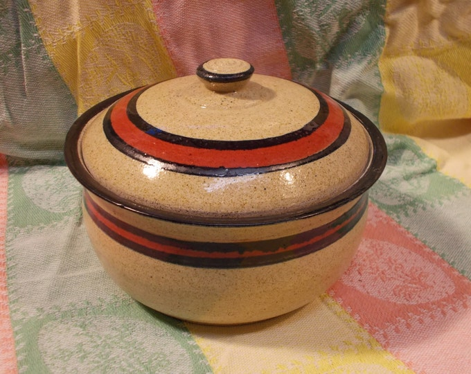 Covered stoneware cassarole dish for oven, serving, display or storage.