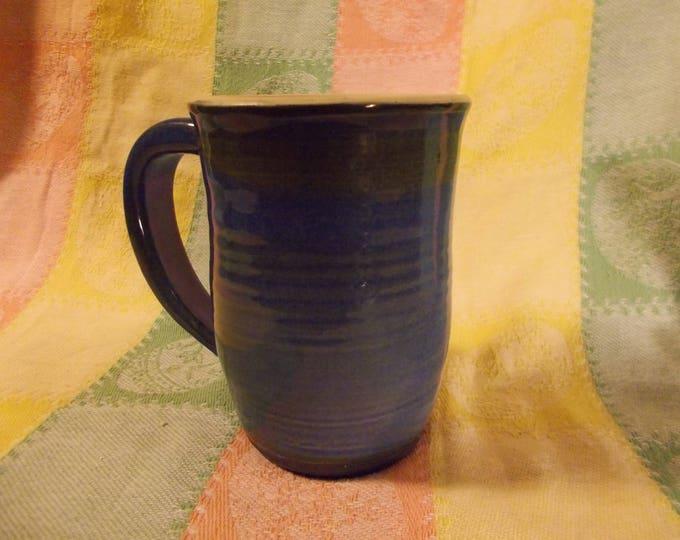 Blue Iradecent Coffee Mug holds 14oz