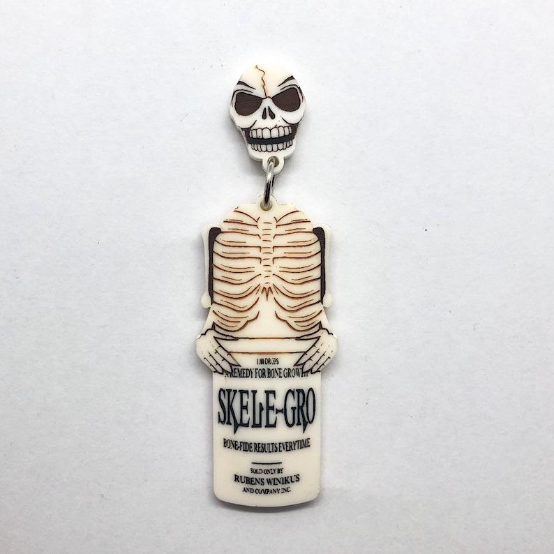 PREORDERSkele-gro potion bottle lasercut acrylic Earrings image 0