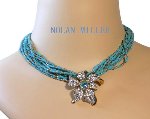 Nolan Miller floral choker,  multi strand blue beads with removable slide pendant of clear and blue rhinestones