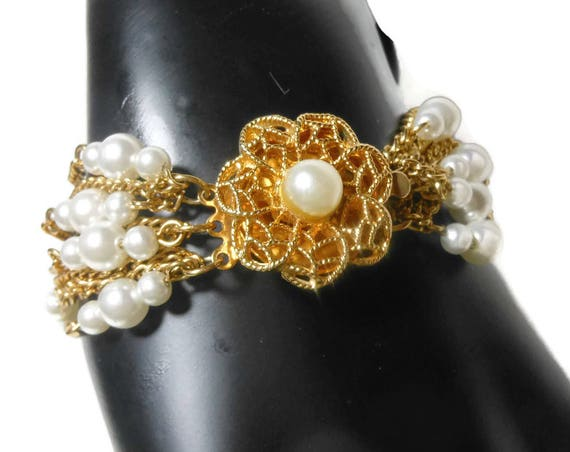 Multi strand pearl bracelet, faux pearl and gold chain bracelet, decorative box clasp center, 11 strand