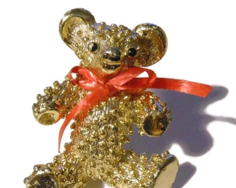 Teddy bear brooch, bear with red paper bow, adorable companion with bumpy textured with black enamel eyes and nose, light gold tone