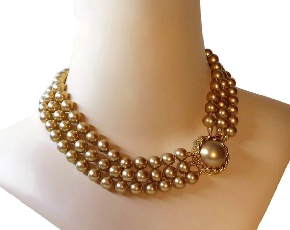 Faux pearl choker, 3 three strand knotted golden champagne pearls with decorative clasp cabochon with a rope frame, gold plated