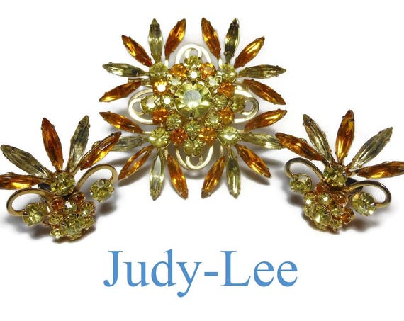 Judy Lee brooch and earrings, signed brooch and clips amber and yellow navettes  and rounds, pronged light gold, clip earrings