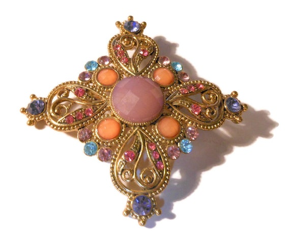 Large rhinestone brooch pendant, pink, blues and purple rhinestones with purple and orange faceted glass cabochons, gold plated open work
