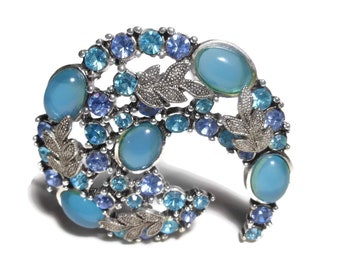 Blue swirl rhinestone brooch, light blue cabochons and chatons, paisley shaped, silver leaves, turquoise blue