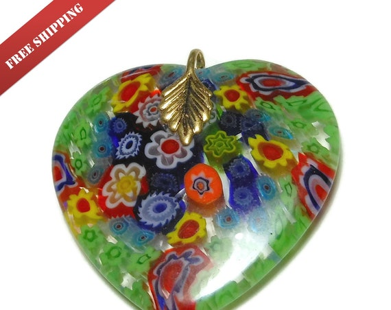"Millefiori glass pendant, 1 1/4"" heart shaped clear background, green yellow blue orange and red flowers, gold plated bail"