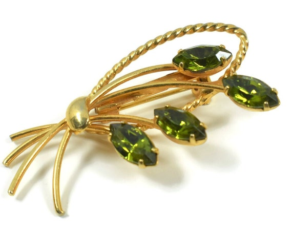 Emerald rhinestone floral brooch, marquise-cut green prong-set rhinestones form a delicate bouquet with gold accents.