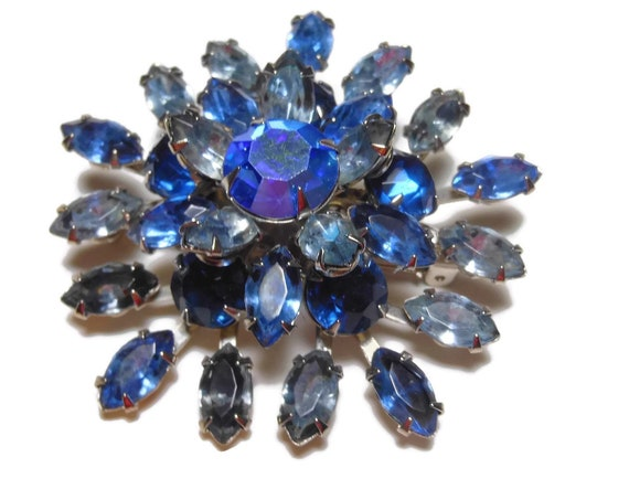 Blue rhinestone brooch, dark and light blue navettes, layered faceted, classic construction
