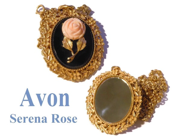 Avon rose cameo pendant, 1973 'Serena Rose' coral floral necklace, black background, gold floral frame leaves and chain, mirror on reverse