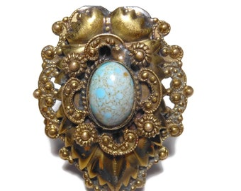 Turquoise dress fur clip, faux turquoise cabochon, brass colored, shield shape, ornate frame, 1940s