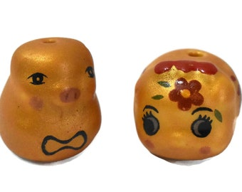 Porcelain pig beads, 2 piece lot, gold piggy figurine beads, ceramic Kawaii beads, one with bowtie one with Kanji Japanese symbols on sides