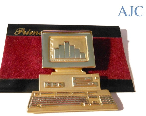 NOS AJC computer brooch, AJC for Primavera, gold signed designer pin, matte and shiny finish, bar chart on screen, desktop with keyboard