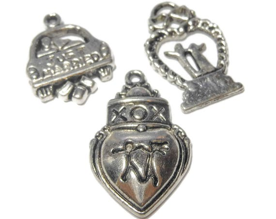 "Just married charm pkg of 9 charms, antiqued silver, (3) 16x16mm ""JUST MARRIED""car, (3) 21x15mm cake topper and (3) 23x16mm fancy heart"