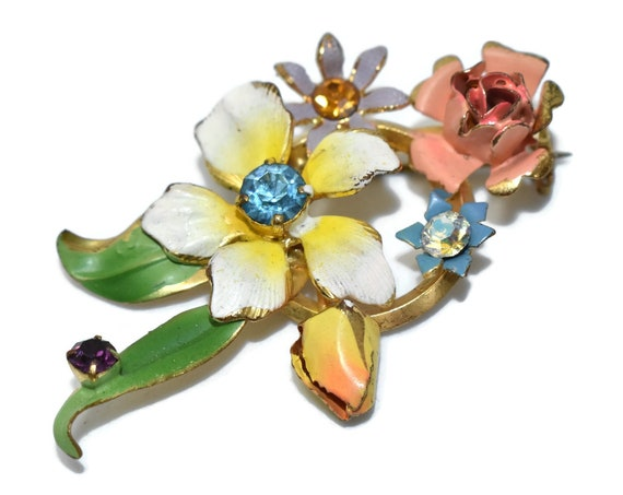 Rhinestone floral brooch, white yellow coral purple blue flowers, blue gold amethyst and aurora borealis rhinestones, green enamel leaves