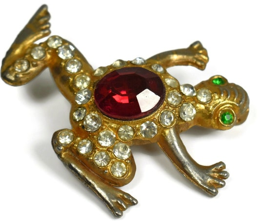Pave rhinestone frog brooch, gold over silver frog with ruby red cabochon center, green rhinestone eyes and clear rhinestone decoration