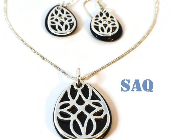 SAQ necklace earrings original box, openwork silver-plated teardrop on a black teardrop, curb chain, rhinestone centers French wire earrings
