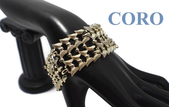 Coro panel bracelet, six-panel link, light gold plated, textured, elegant, rare 1940 find