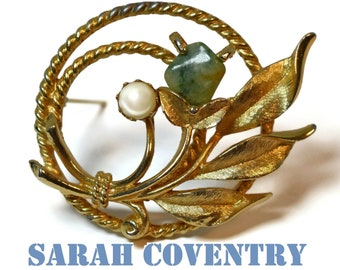 Sarah Coventry circle brooch, 'Jade Garden' 1966, rope textured gold plated pin with a bouquet of a jade flower, faux pearl and gold leaves