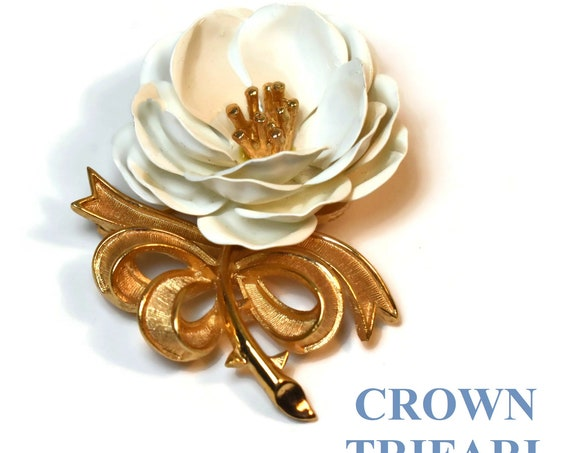 Crown Trifari floral brooch, White enamel flower brooch, gold stamen in center of white enamel petals, stem tied with a brushed textured bow