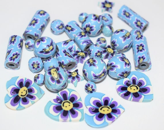 Bead mix, polymer clay, multicolored, 5mm-22x21mm mixed shape with flower and smiley face design, 1.7-2.4mm hole. Sold per pkg of 36.