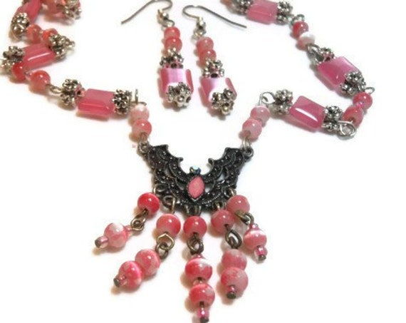 Pink fiber optic glass necklace and earrings made with upcycled beads and festoon beadwork earrings in silver plate