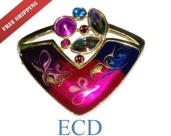 Rhinestone aurora borealis crystal brooch with enamel swirls work modernist signed ECD with in gold tone setting