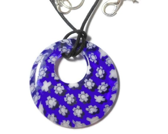 Millefiori glass pendant, 30mm round blue background, white flowers, round go-go on black cord, silver plated findings