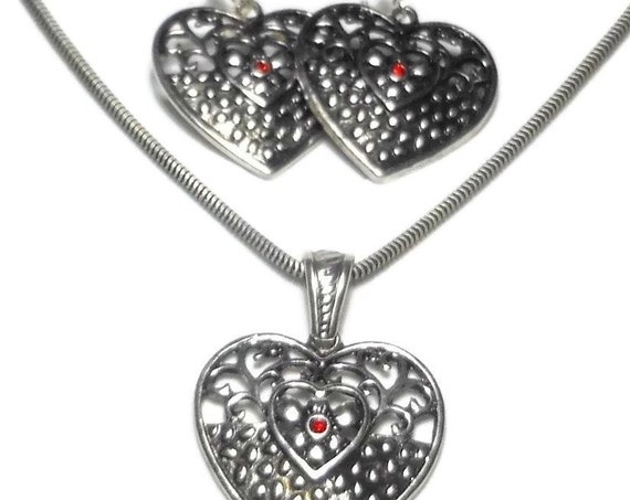 Silver filigree heart set, silver pendant on chain and earrings with red rhinestone hearts, silver plated, lever back pierced earrings