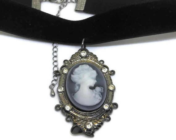 Gunmetal cameo choker, white on grey background, gunmetal frame with rhinestones, black velvet choker gunmetal extension.
